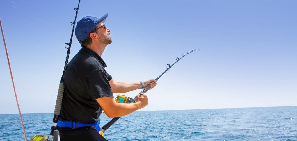 fisherman-reeling-in-offshore-fishing-catch
